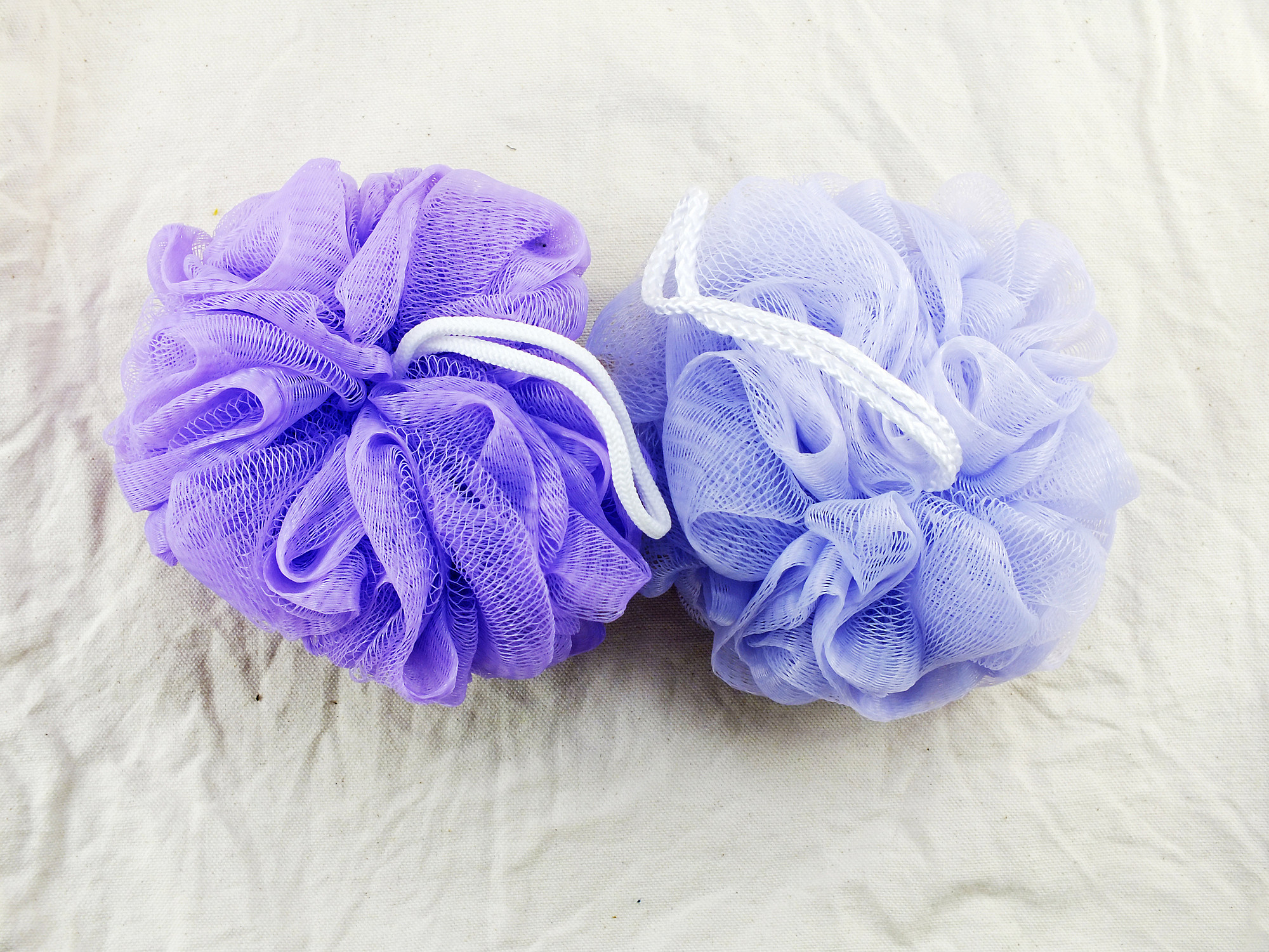 plastic bath puff and sponge for shower cleaning